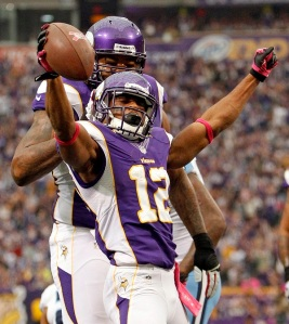 Minnesota Vikings wide receiver Percy Harvin celebrates with teammate Phil Loadholt after he scores a touchdown against Titans in Minneapolis